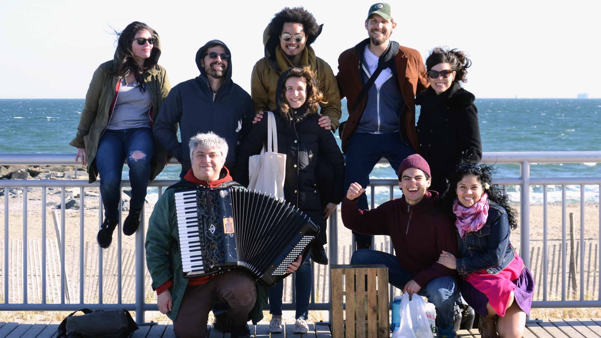 At Rockaway Beach, the day of our first performance. Back row: Lindy Lofton, Jedadiah Schultz, Will Shaw, Per Janson. Middle row: Sylvia Kates, Robin Galloway. Front: Daniele Mutino, Bradley Tejeda, and Annie Henk.