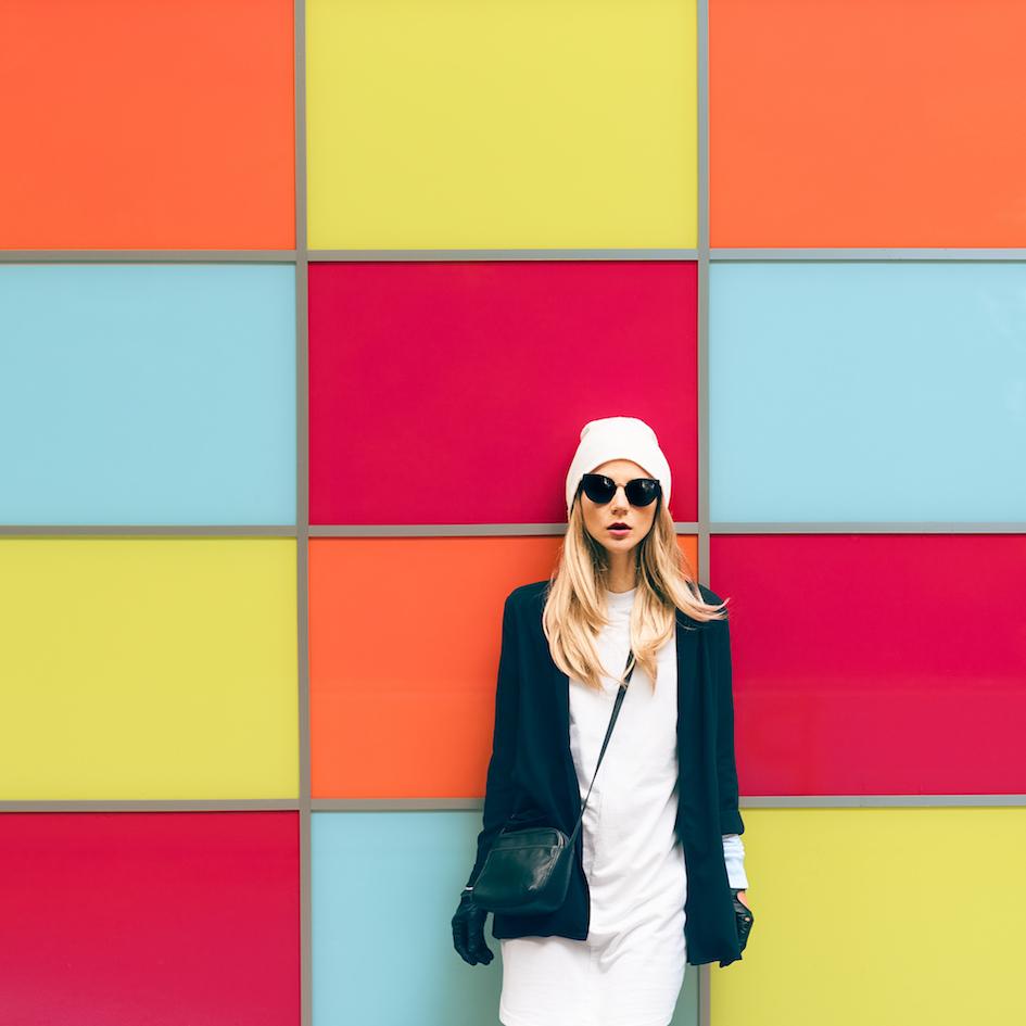 woman maintains cool near a bright wall