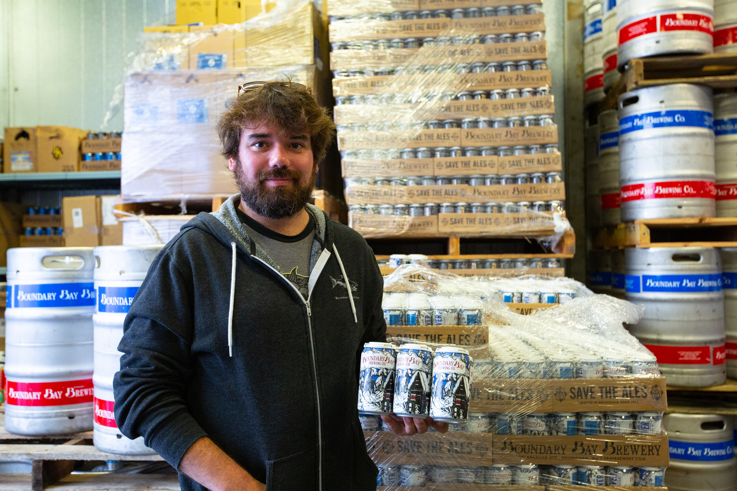 Artist, Evan Whitehead with Cabin Fever cans.