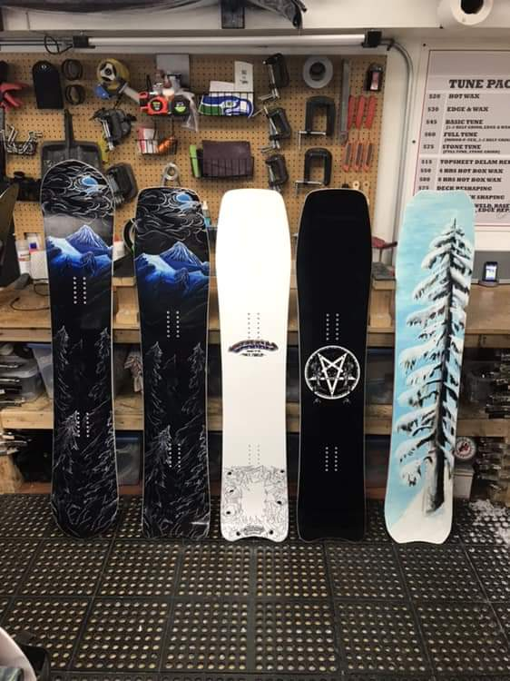 Snowboards Evan has painted in the past.