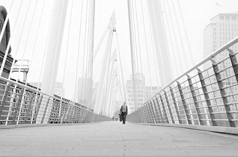 Man-walking-over-bridge-london-iconic.jpg