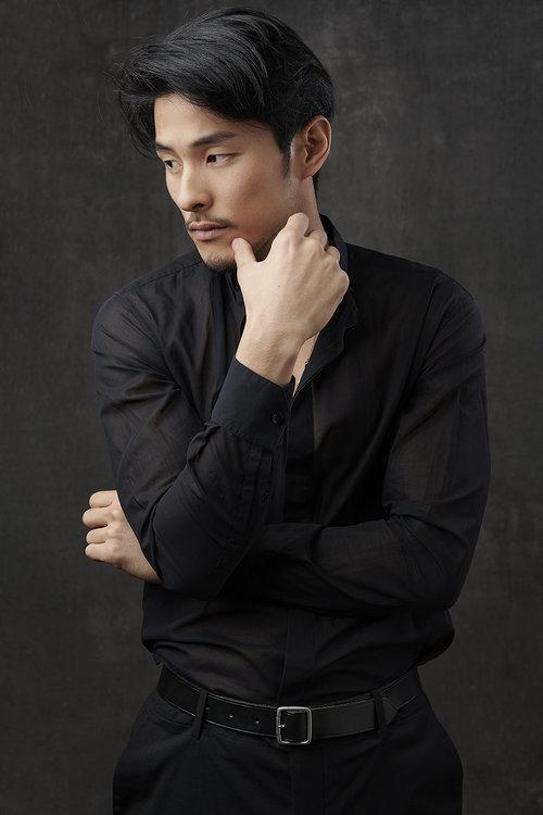 Man-portrait-standing-thoughtful-blackhair.jpg
