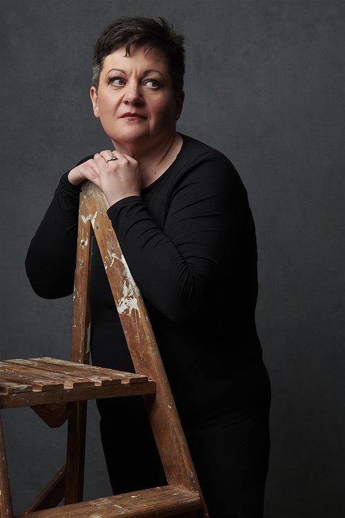 Woman-portrait-standing-ladder.jpg