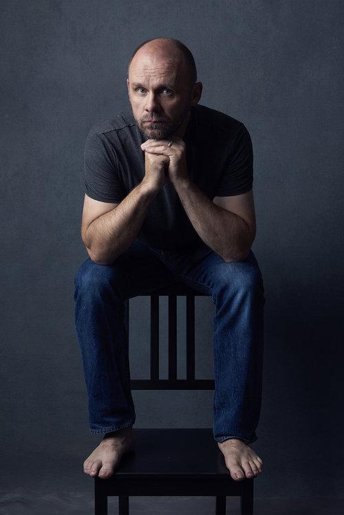 Man-sitting-onchair-Andrew-Clifton-Brown.jpg