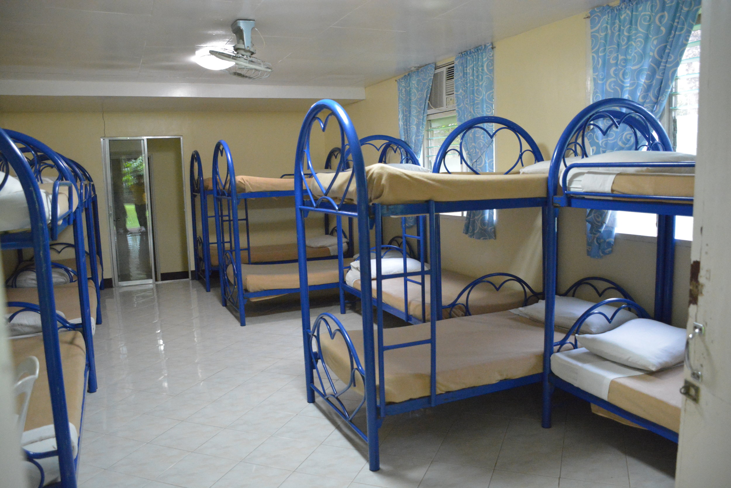 Deluxe Cabin Package PHP 1500 per person.   The accommodations for this package include AC Deluxe Cabins. Each Cabin holds 16 pax. They are assigned based on headcount of the group. Each Cabin has its own bathroom. (rate is adjusted for less than 12 pax in a room) Capacity is 60 pax.