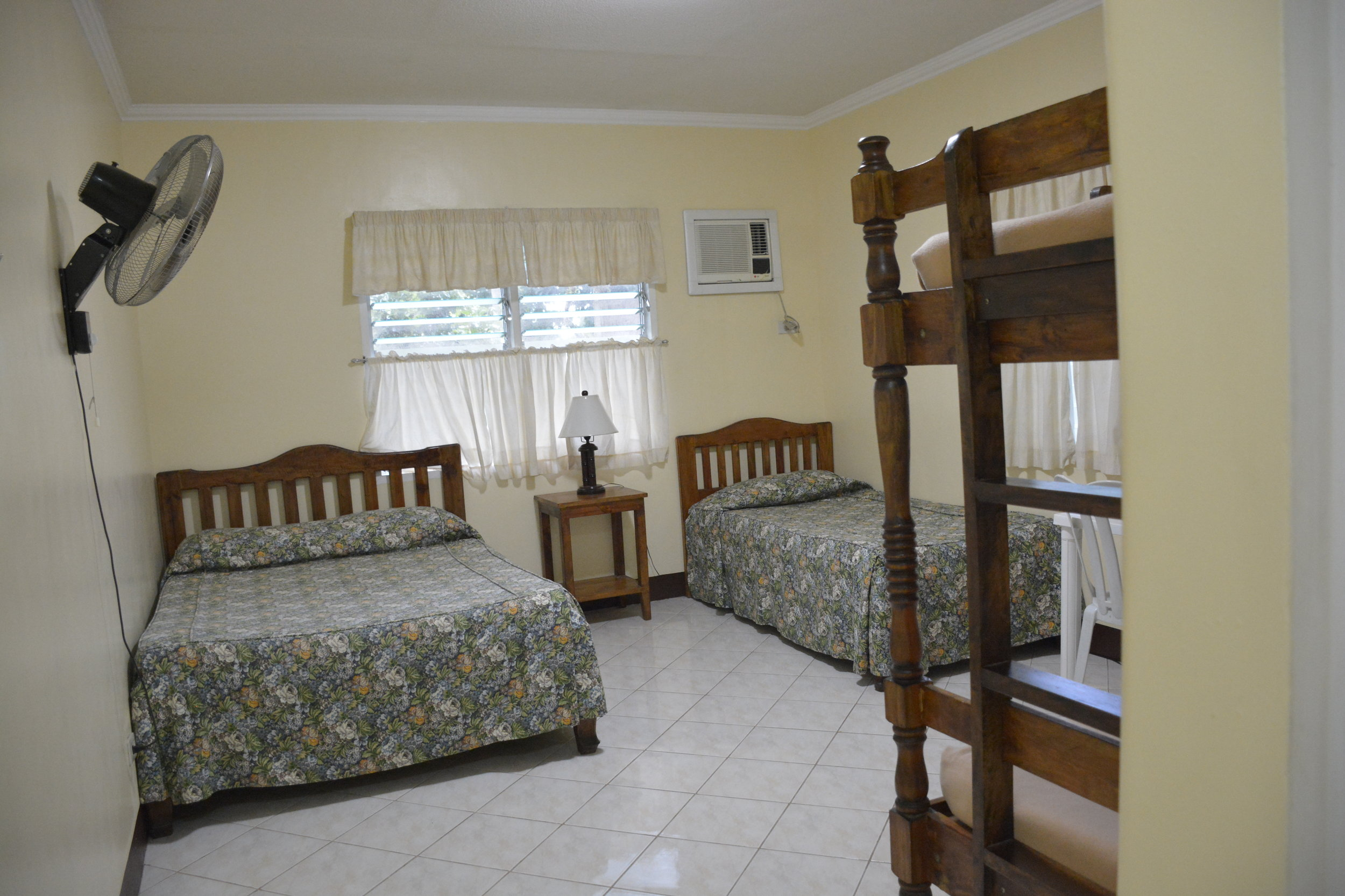 Family AC rooms.   This package includes AC Guest Rooms. These rates below are based on the number of occupants per room. It is possible to put 5 in a room with an extra mattress or bed sharing. Rooms are assigned by chosen occupancy rates per room.  1. Single Occupancy Php 4100 per person  2. Double Occupancy Php 2650 per person  3. Triple Occupancy Php 2067 per person  4. Quadruple Occupancy Php 1775 per person  5. Quintuple Occupancy Php 1600 per person