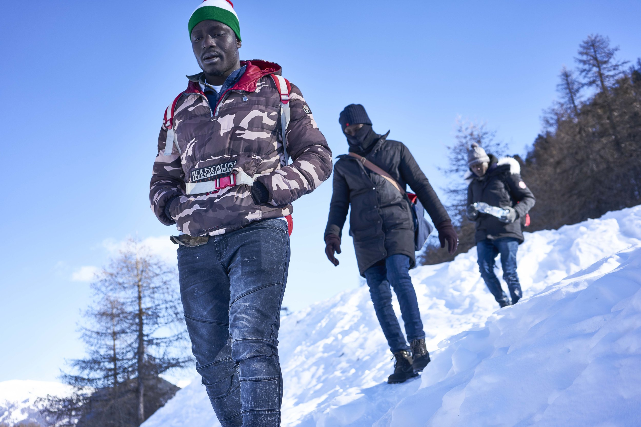 EPISODE 3 - In 2018 about five thousand people crossed the border between Italy and France passing through Bardonecchia and Colle della Scala. At least three people died along the way because of hypothermia or because they got lost or fell into a crevasse. In the first months of 2019, every night between ten and fifteen migrants are rescued on the paths that connect Claviere, in Italy, to the Montgenèvre pass, in France. In most cases the French gendarmerie stop them, bringing them back to the Italian side, operating illegal group rejections without evaluating their asylum applications. But after a few days the boys try to cross the border again.