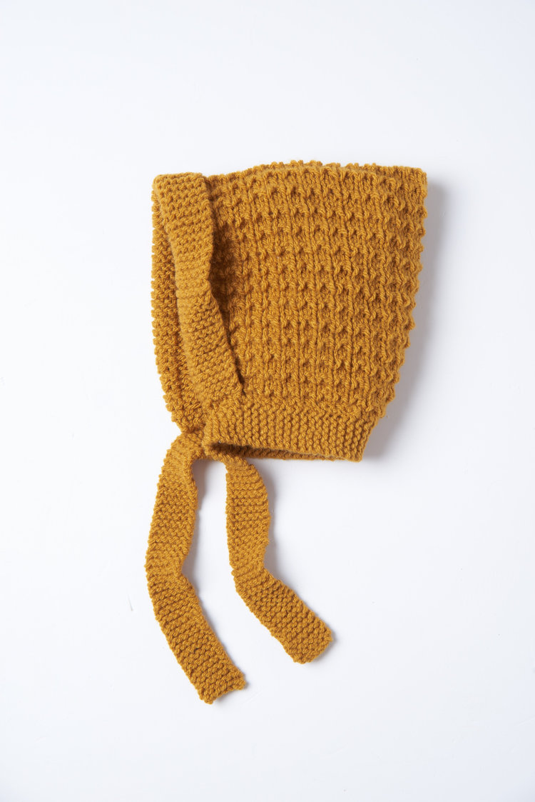 Mustard bonnet - Babies in winter need hats. This one will actually stay on and keep little ears cosy too,£22What Mother Made