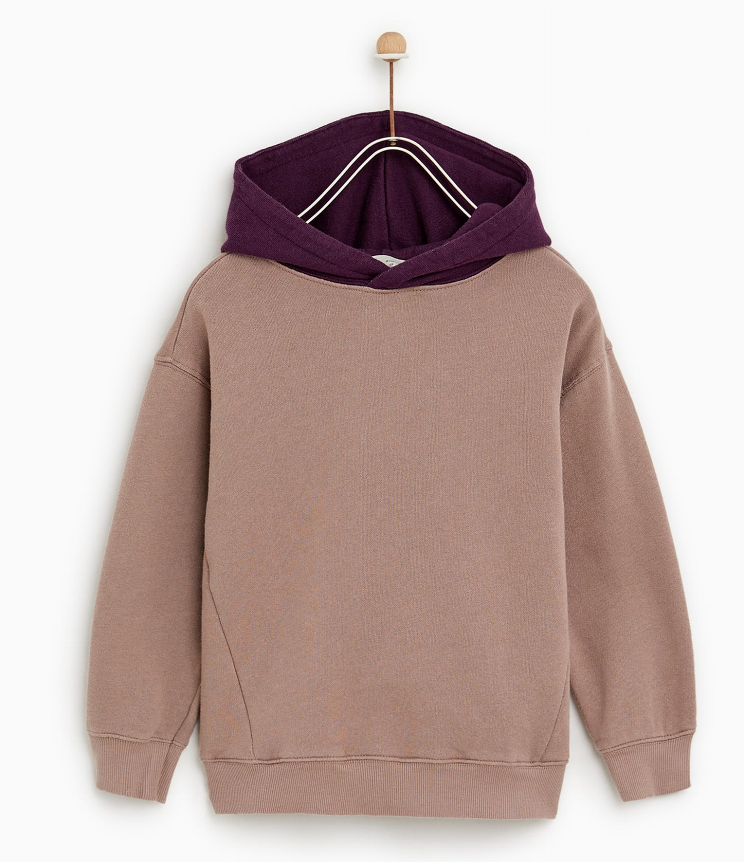 Hoodie - Ultra-cosy and in really nice colours, Zara's hoodies are a gem this season. We love this purple and washed plaster pink one.£14.99Zara