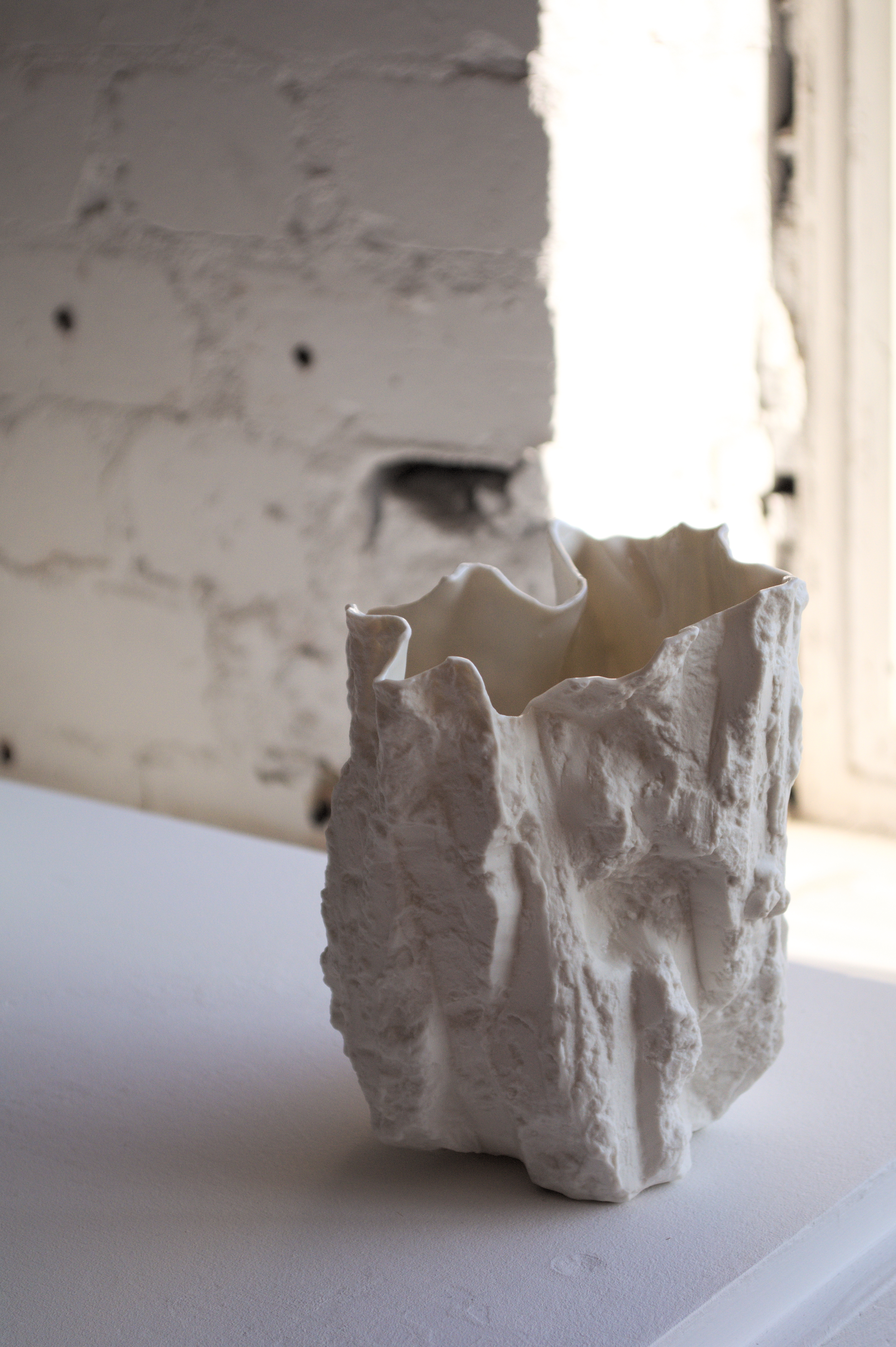 Cut no. 6, 2019. 14.5x12x10cm.   Slip cast porcelain, edition of 15.