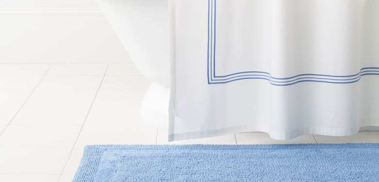 Blue accent shower curtain and blue bathroom rug