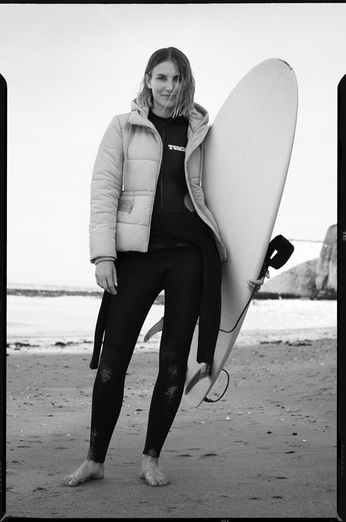 """Sophie Hellyer - Sophie is a former British surfing champion, avid environmentalist, public speaker and cold water swimmer.She is passionate about protecting our oceans and empowering women. She is determined to reshape the visual narrative of surfing, fostering a more healthy, diverse and inclusive sporting culture.""""Surfing has given me everything from tools to deal with depression and anxiety to environmental awareness, my community and even my career. I want everyone to have access to surfing which is why I support GET OUT as an ambassador""""."""