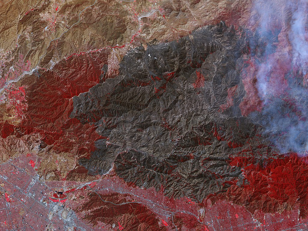 An aerial view of the 2009 Station Fire, which ravaged a 252-square-mile area of Southern California's La Crescenta foothills, and sparked multiple catastrophic mud slides was the result of severe climatic conditions, cyclical weather cycles, and an outdated, aging infrastructure.