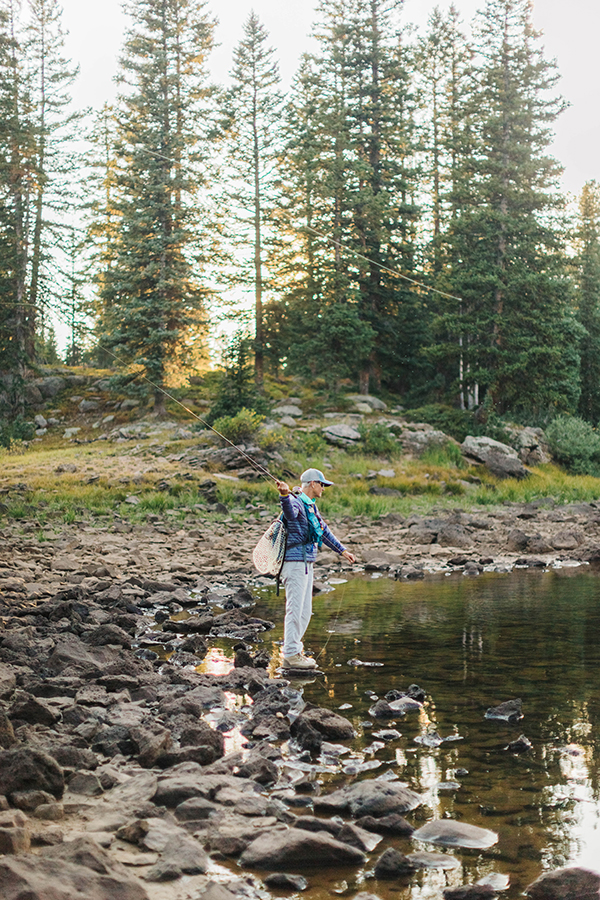 Fly fishing fisherwoman on Grand Mesa, Colorado