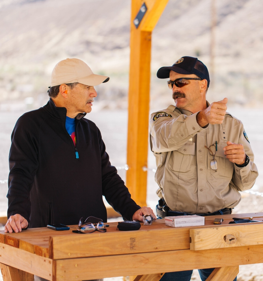 Proulx talks safety with writer Richard Rosenblatt, who never shot a gun before writing this story. See Rosenblatt's personal essay below.  Photos by Tyler Logan