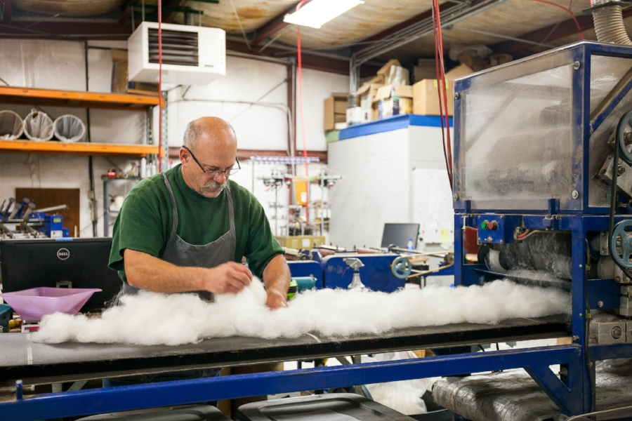 From breeding alpacas to producing goods from their fiber, Mike McDermott is involved in every step of the process. / Photos by Kaylan Robinson