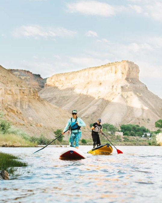 Elizabeth Fortushniak, owner of GJ SUP, and Steve Anderson enjoy a day on the Colorado River near Palisade. / Photography by  Caleb Weaver