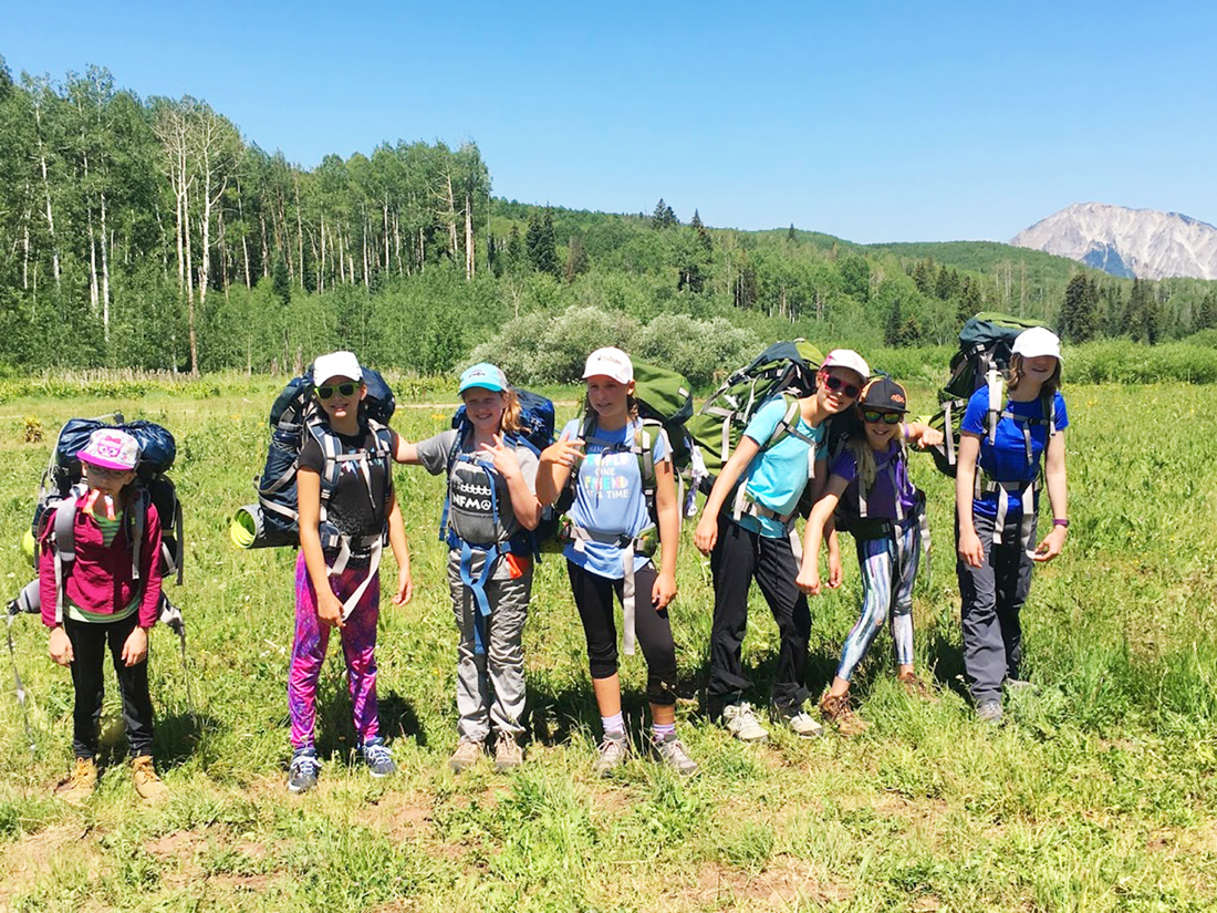 Kids participate in a backpacking trip through The Nature Connection.