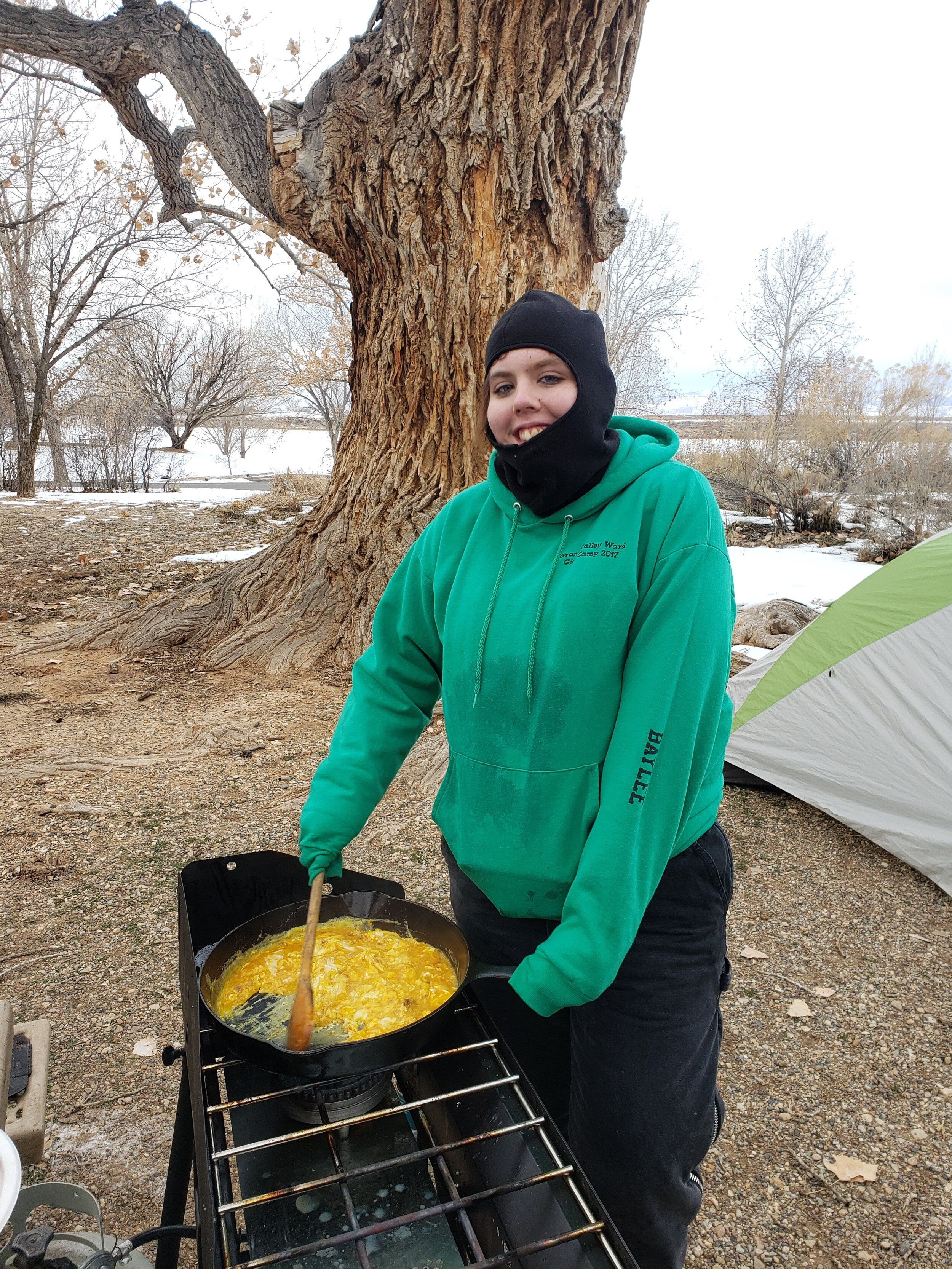PHOTO COURTESY GARFIELD COUNTY OUTDOORS  Baylee Perkins, a senior at Grand Valley High School, prepares breakfast for a group of students on a camping trip early last spring with Roaring Fork Outdoor Volunteers at Highline Lake in Fruita. They camped, hiked, and did some team building and leadership coaching to become closer as a team to kick off their service-centered internship.
