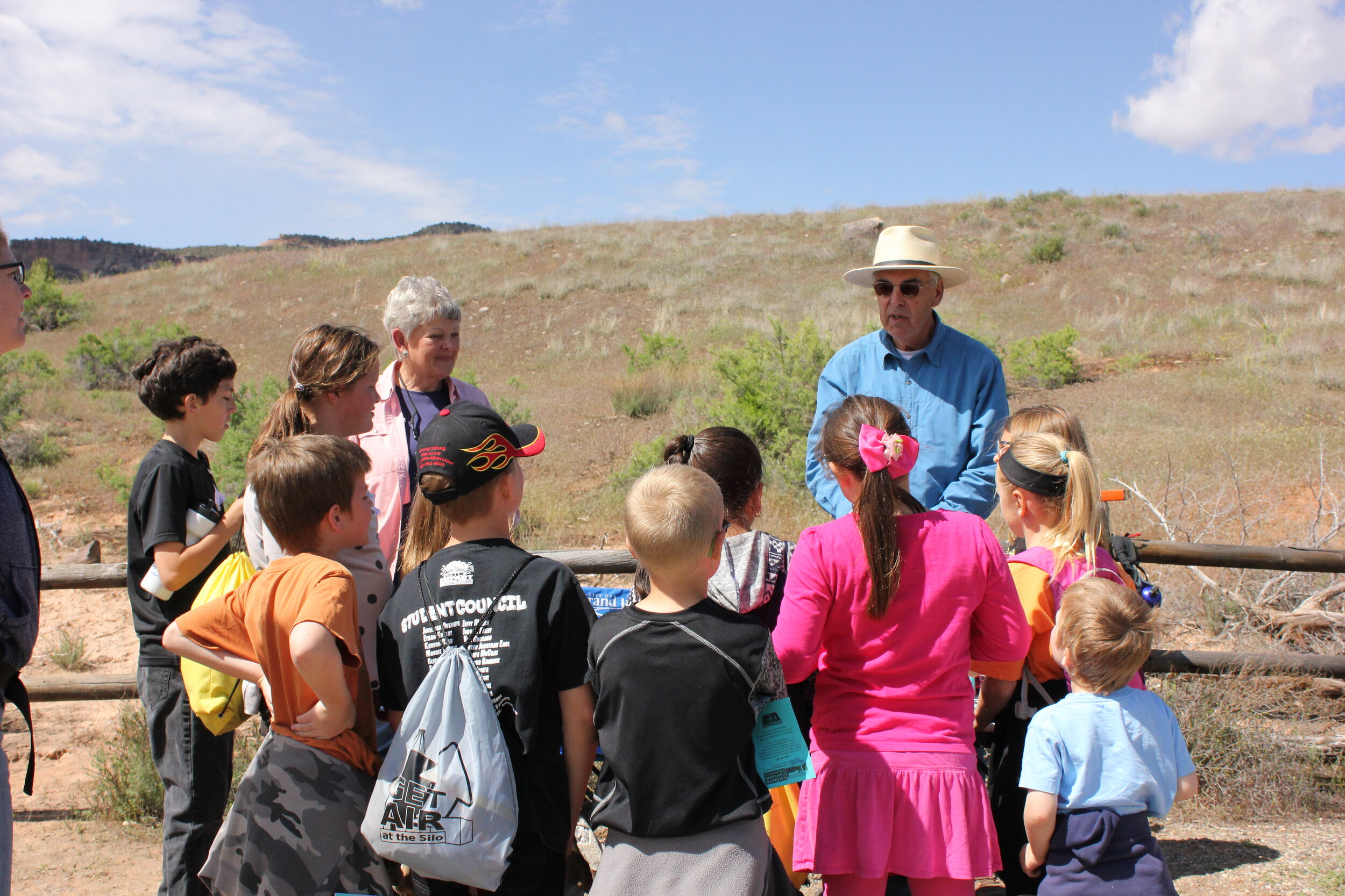 PHOTO COURTESY ROB GAY  CCA volunteers Katie Steele and Owen O'Fallon teach a group of third-graders at Nature Knowledge Days in McInnis Canyons National Conservation Area