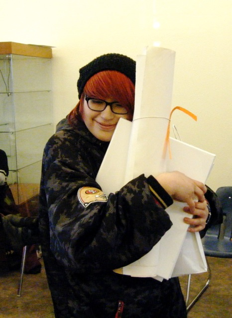 Fawn receiving free art supplies.