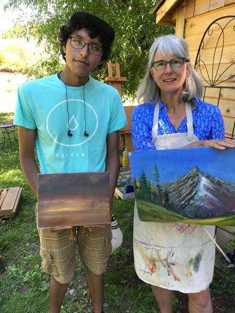 Mentor Susan Fletcher with student Jace at an oil painting workshop.