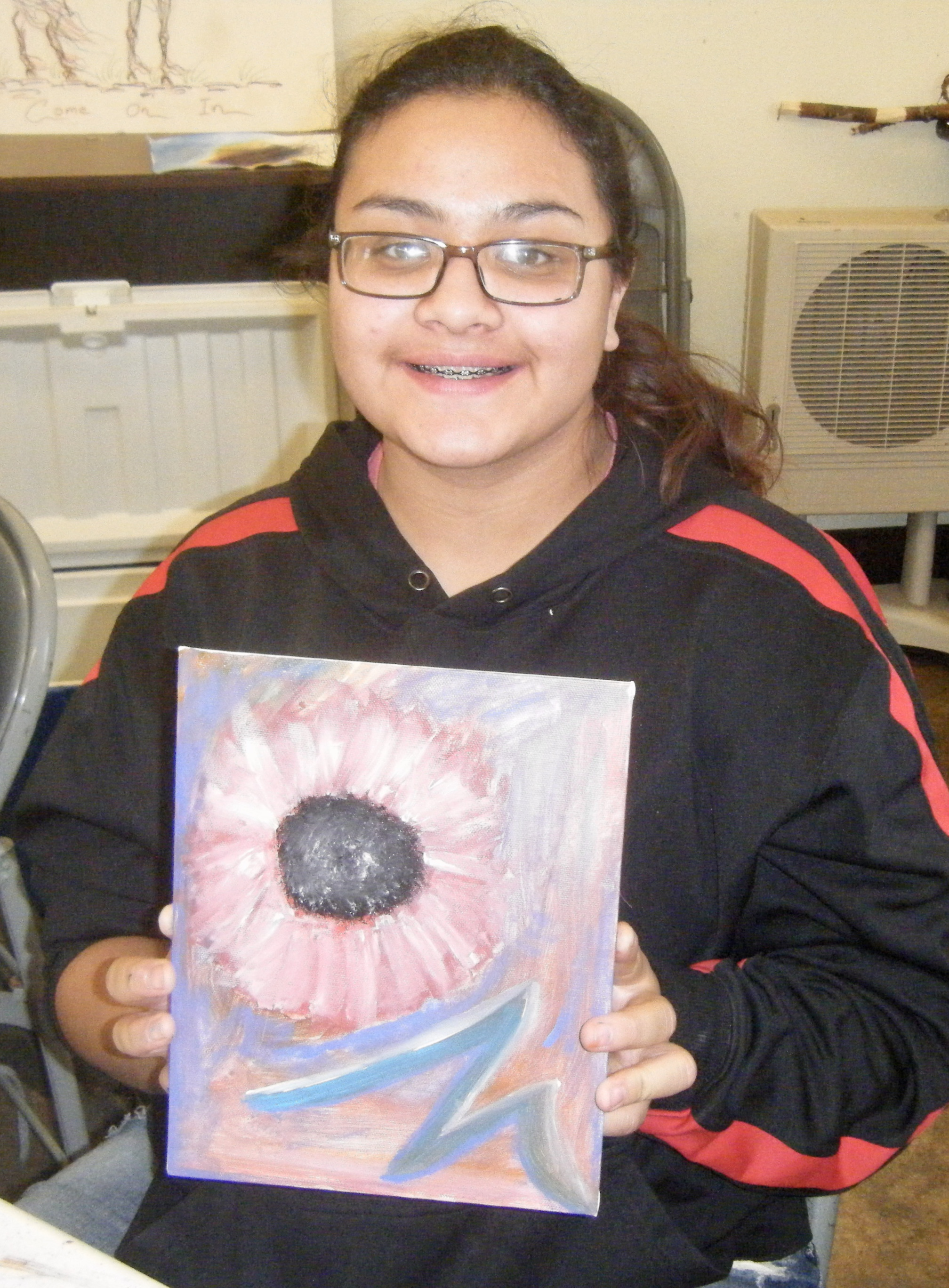 Mariah shows her artwork during the Acrylic Painting Workshop.
