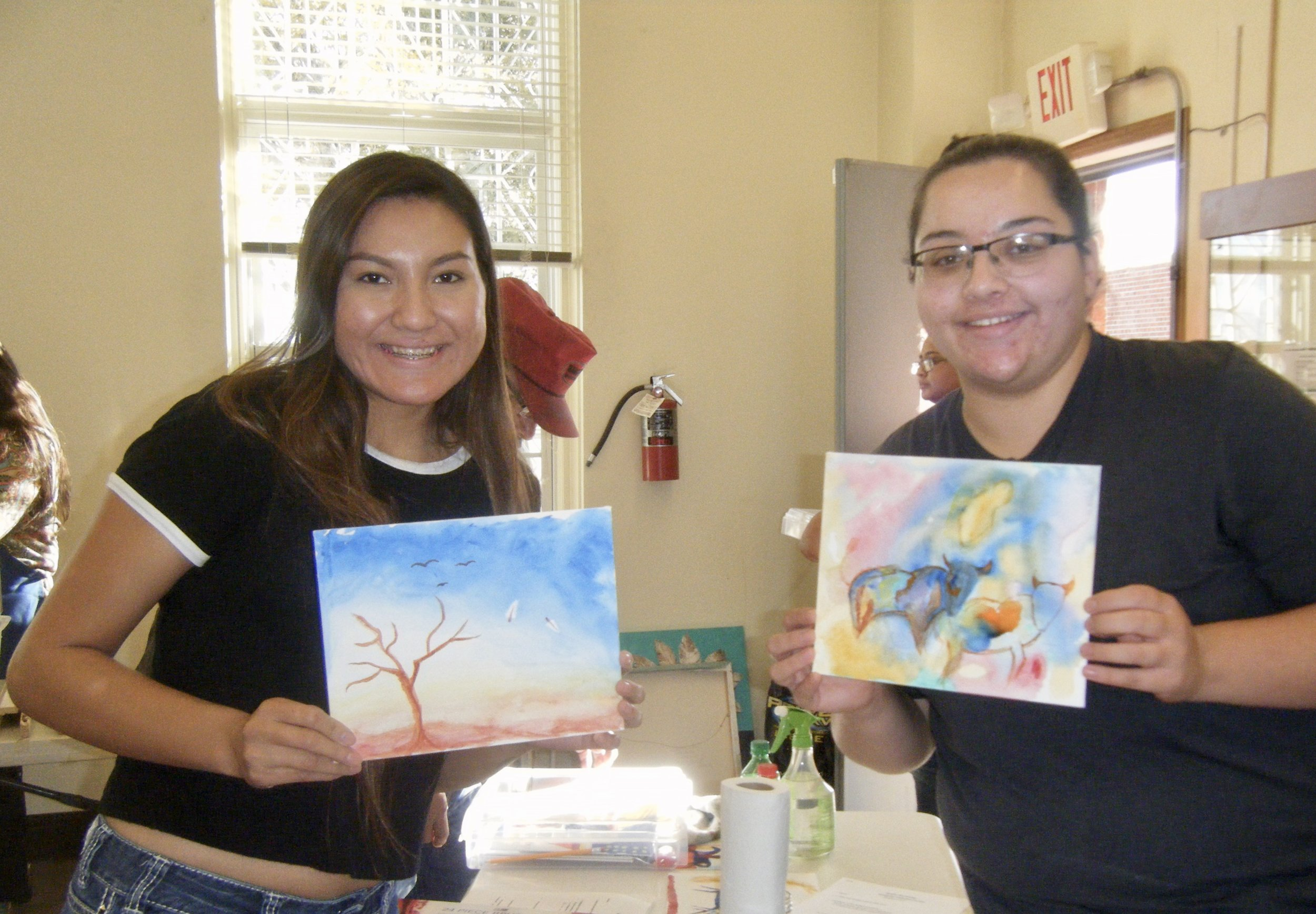 Raynell and Kimberlee show their works-in-progress during the Acrylic Painting Workshop.