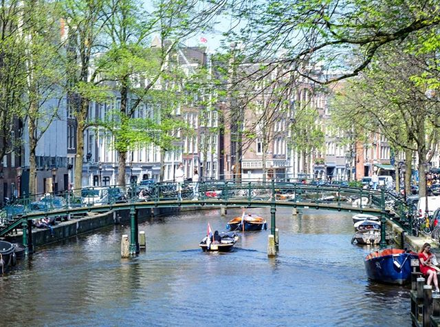 Day 223: The canals of Amsterdam are the city's most distinct feature. They start at the very center and ripple out like circles, forming a complex network of waterways. Holland is beautiful in the spring.  #Amsterdam #canal #bridge #bridgesformanee #Holland #Netherlands #worldtravel #travelblogger #travelphotography #travelphotographyoftheday #travel #traveler #roundtheworld #globetravel #worlderlust #travelpics #Instagram #instatravel #lonelyplanet #travelgram #travel #instaphoto #photography #Fujifilm #XT2