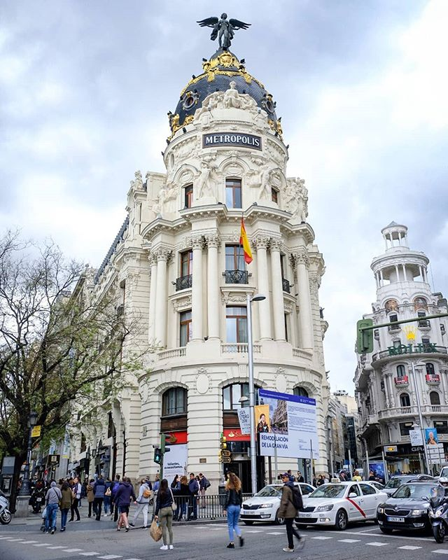 Day 232: The beautiful Metropolis building on Calle de Alacalá is one of the many stunning landmarks we've seen in Madrid so far.  #Metropolis #Madrid #Spain #España #Spanish #architecture #architecturelovers #clouds #worldtravel #travelblogger #travelphotography #travelphotographyoftheday #travel #traveler #roundtheworld #globetravel #worlderlust #travelpics #Instagram #instatravel #lonelyplanet #travelgram #travel #instaphoto #photography #Fujifilm #XT2