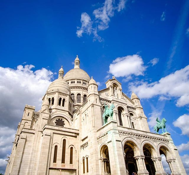 Day 230: We had a fun afternoon getting to the top of Montmartre where we visited the Sacré Coeur Basilica and then enjoyed walking back down though the neighborhood.  #Paris #France #French #Montmartre #streetlife #streetphotography #sunshine #bluesky #clouds #worldtravel #travelblogger #travelphotography #travelphotographyoftheday #travel #traveler #roundtheworld #globetravel #worlderlust #travelpics #Instagram #instatravel #lonelyplanet #travelgram #travel #instaphoto #photography #Fujifilm #XT2