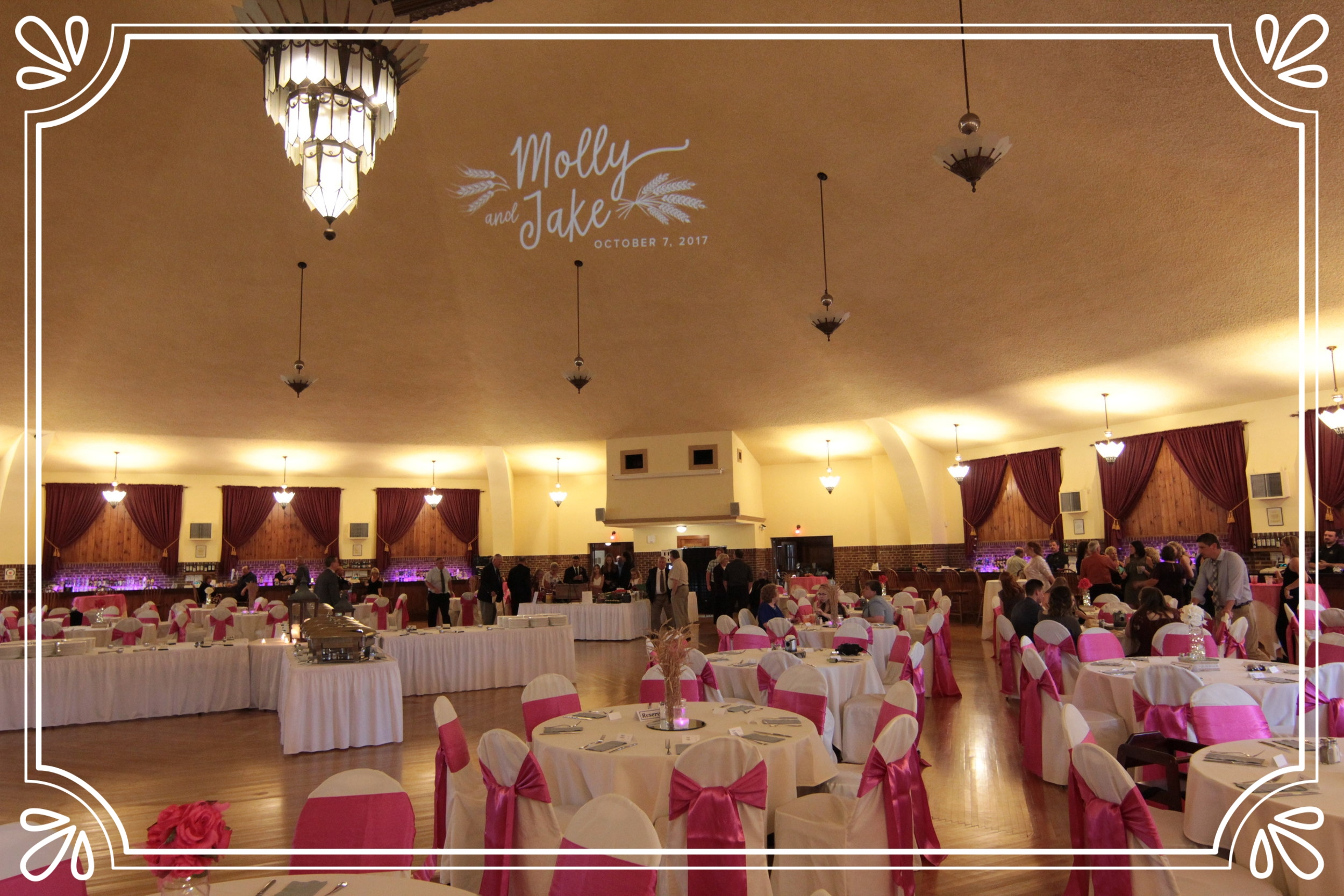 Molly and Jake's custom crafted Monogram we made for them, projected on the ceiling of this grand ballroom in Hartford....