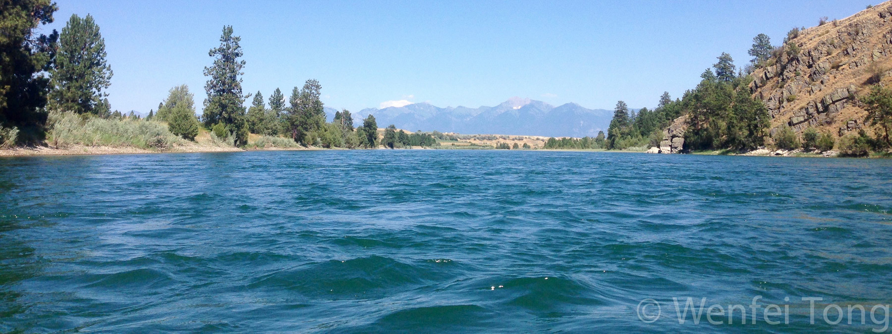 View fof the mission mountains from a float in the middle of the flathead river