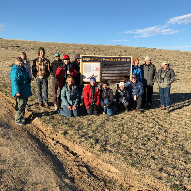 happy crowd after watching sage grouse