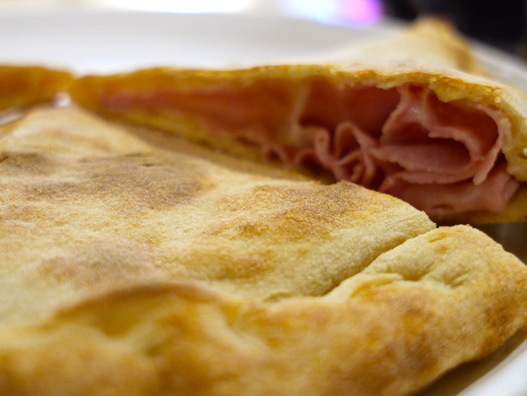 Ham and cheese calzone at La Prezzemolina in Rome, Italy