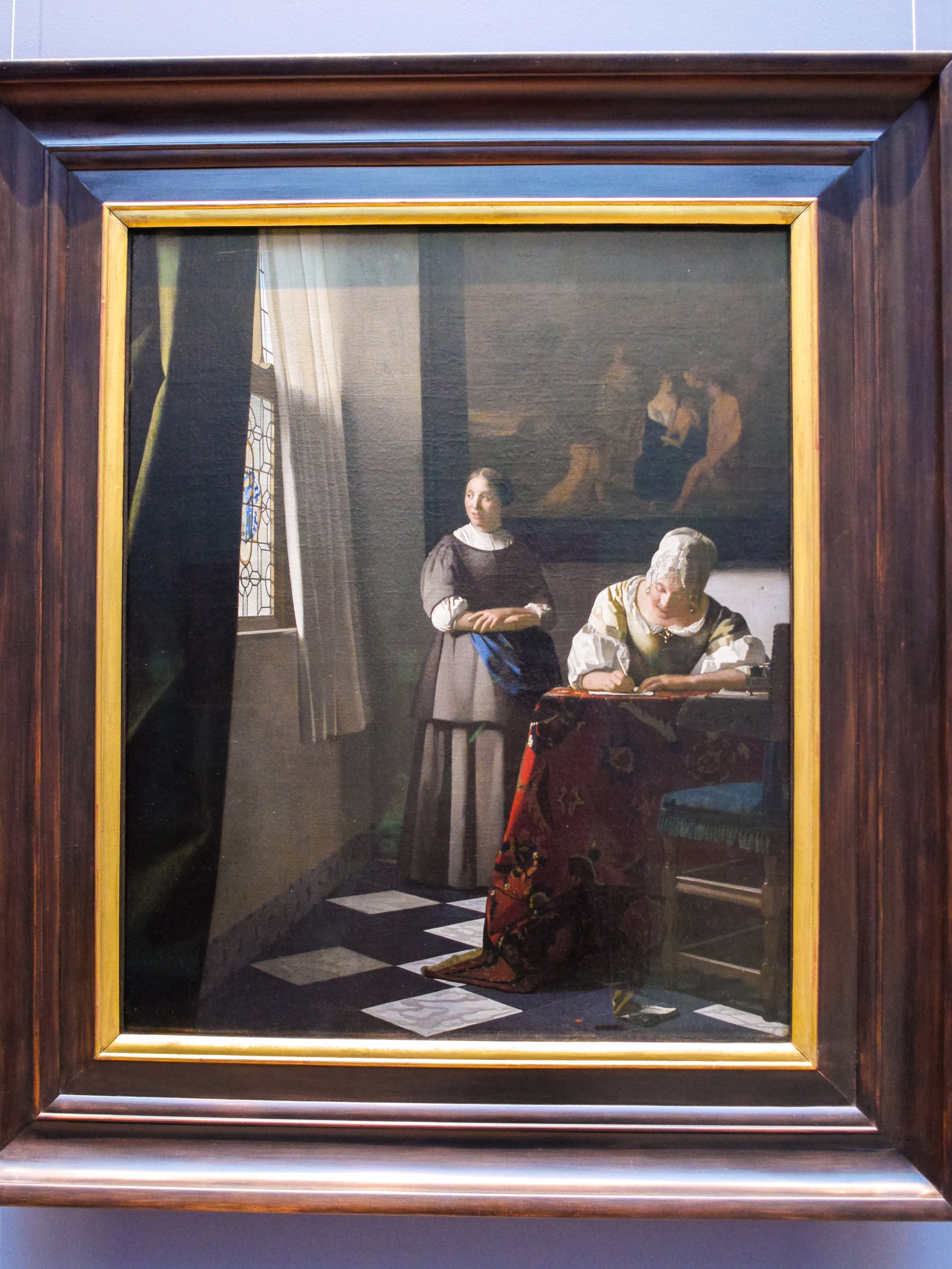 Woman Writing a Letter, with her Maid by Johannes Vermeer.