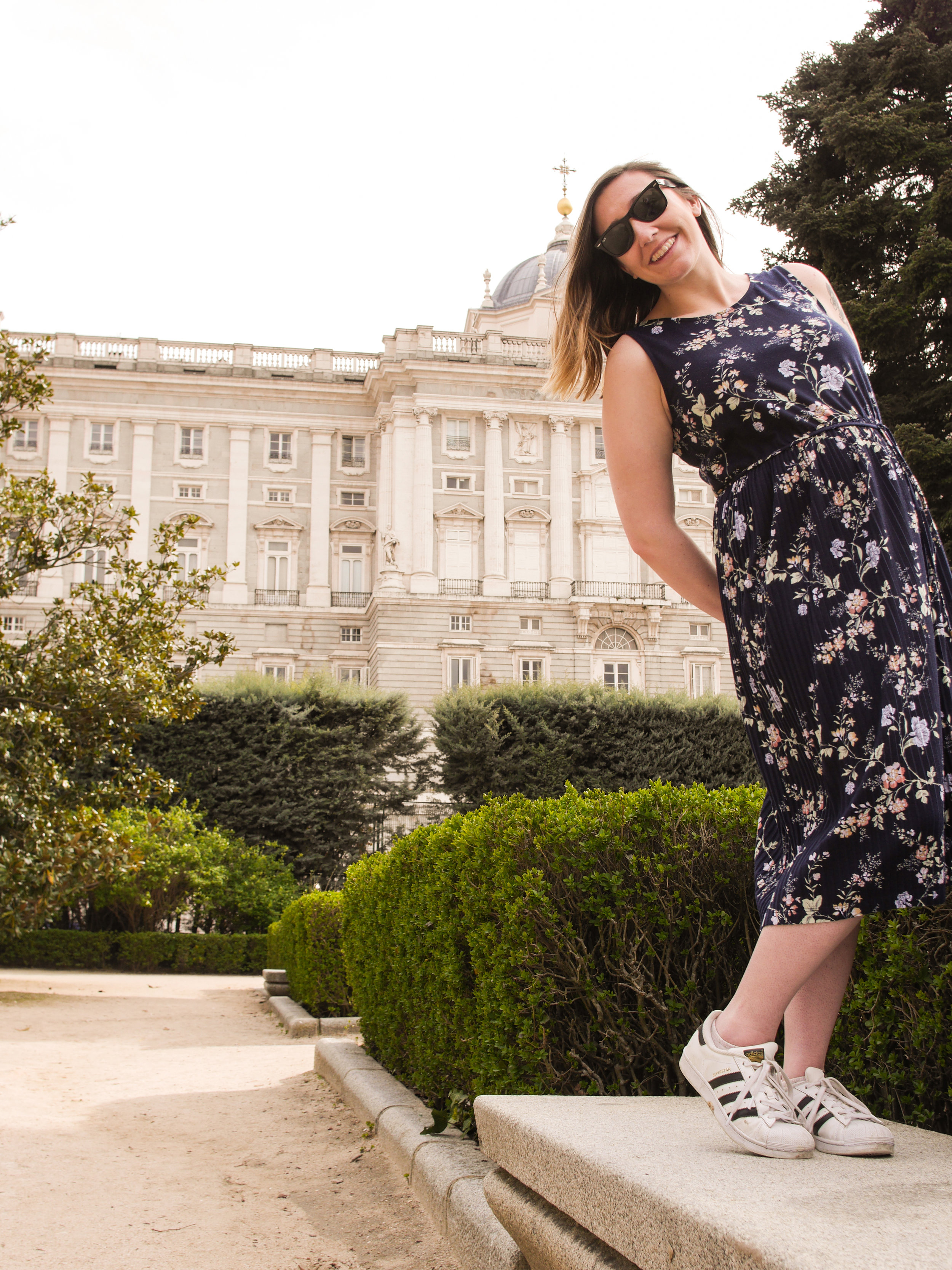 Candid Alexandra in front of the Royal Palace of Madrid in Madrid, Spain