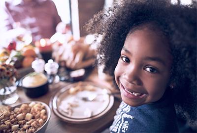 girl-smiling-at-dinner-table.jpg