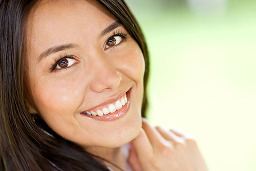 pretty smiling woman with nice white teeth
