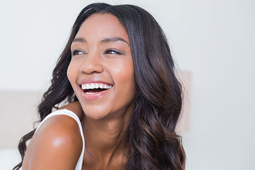 Young woman laughing looking over shoulder