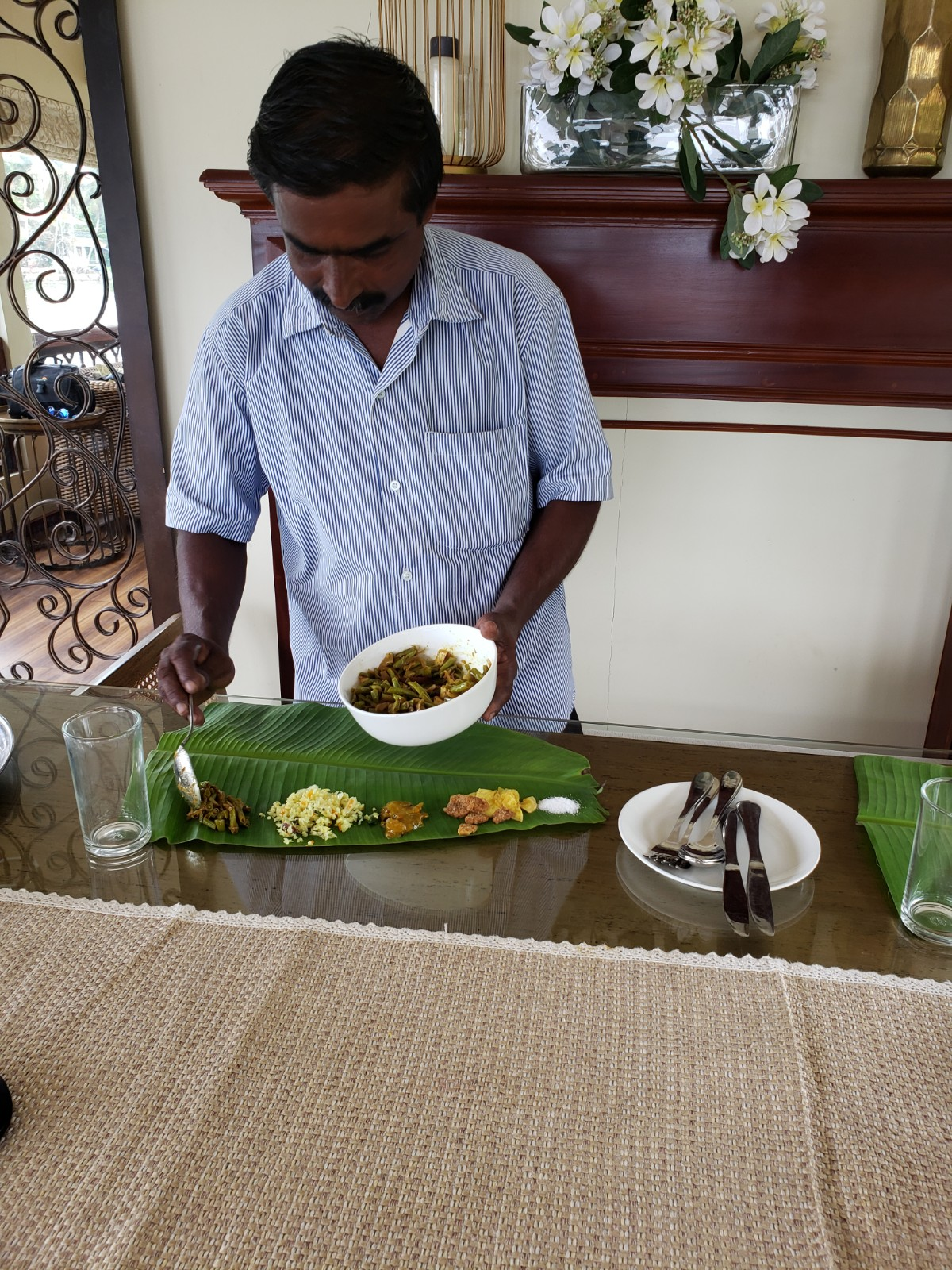 """The food on Spice Route Cruises was phenomenal. Here they are preparing """"Sadhya"""". A traditional Karla dish served on banana leaf. -"""