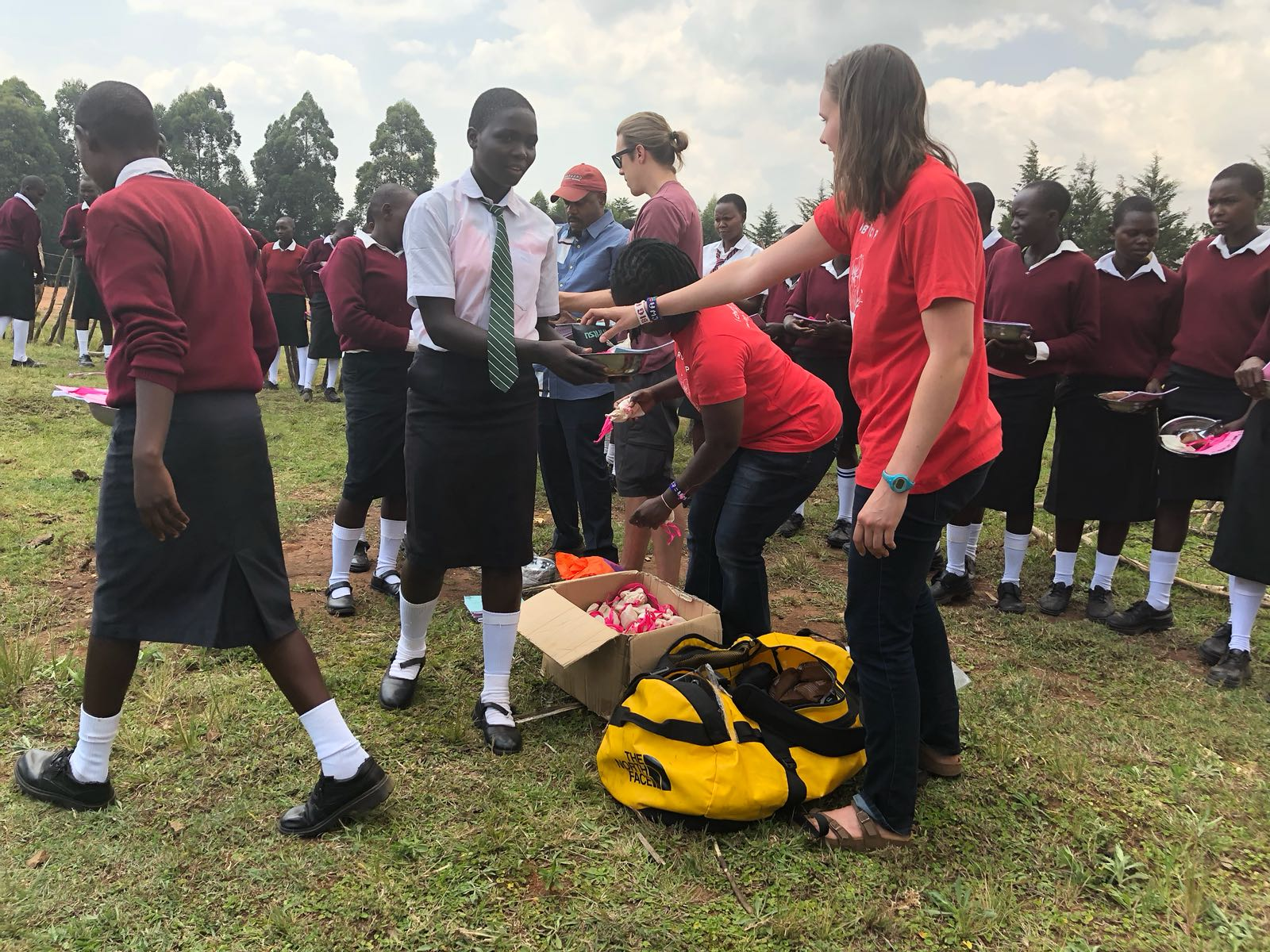 Members of the Cross World Africa team (Kevin, Andrew, and Alyssa) distribute Rift Kits to girls at Shoe4Africa Martin Lel School with Golda of the Golden Girls Foundation.