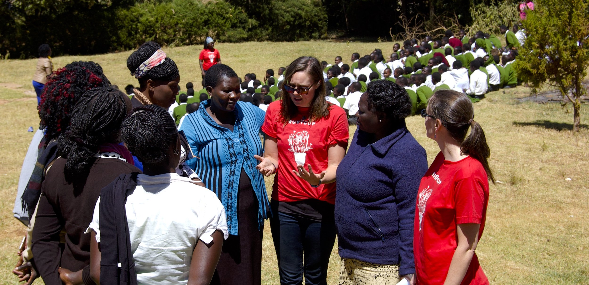 Teresa and I instruct the teachers on how to use the Ruby Cup while Golda engages the students behind us.