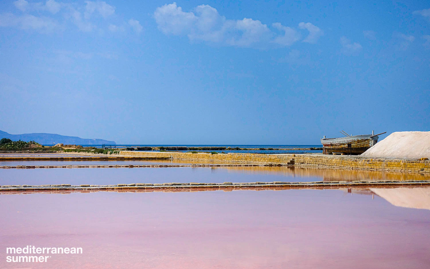 The ancient sea salt pans of Trapani, Sicily are still in use today. (Photo by David Shalleck)