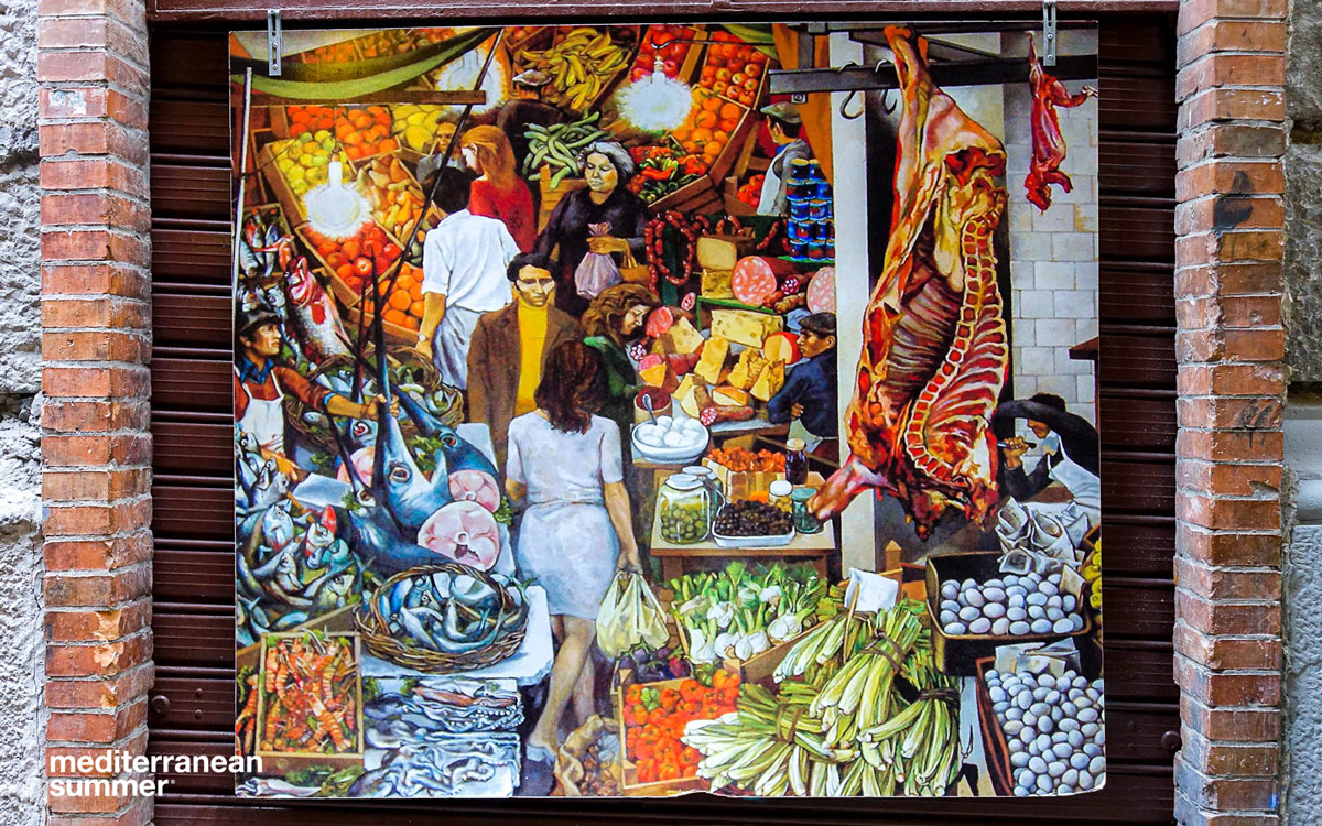 A mural hanging in the Mercato Ballaro, Palermo, Sicily (Photo by David Shalleck)