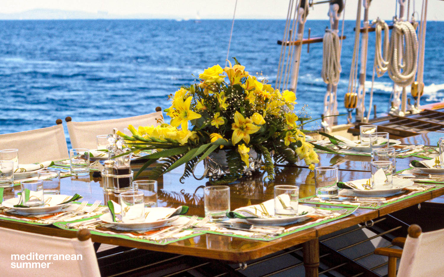 The owner's table is set for lunch amidships on board  S/Y Serenity  while at anchor in Cannes, France. Photo by David Shalleck
