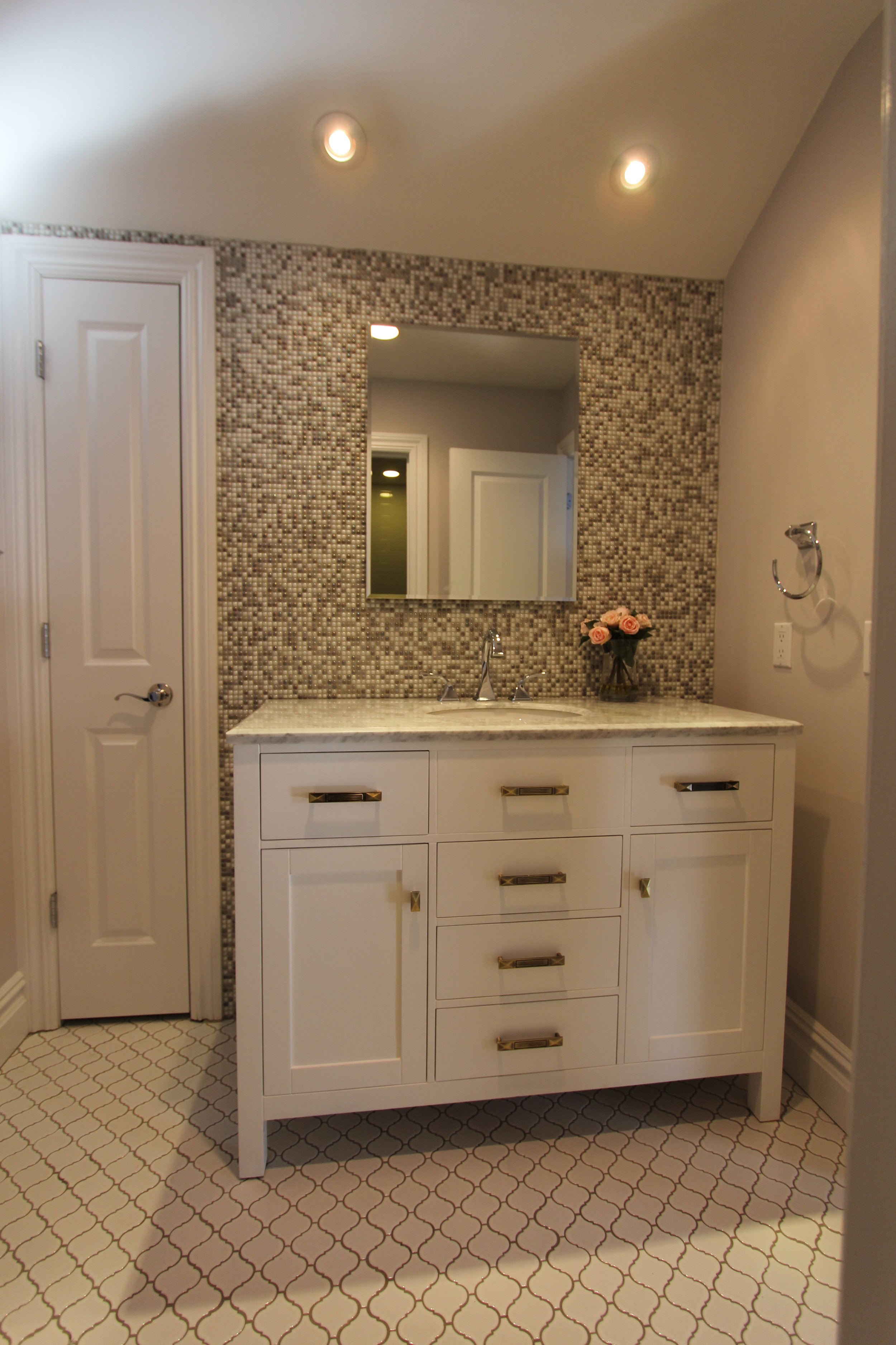 Dainty Kids Bath with Mosaic Feature Wall