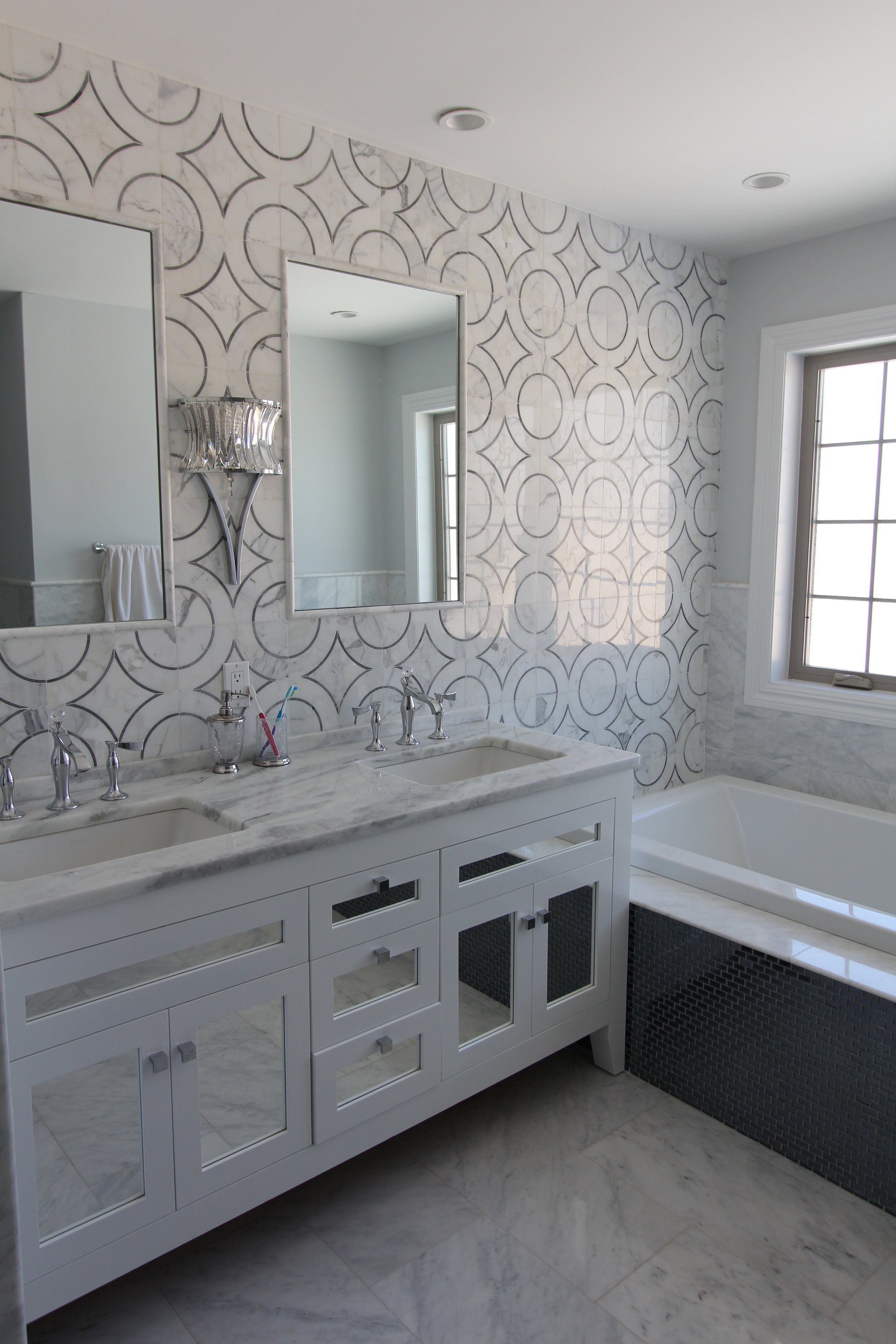 Master Bath with Water Jet Cut Marble Feature Wall
