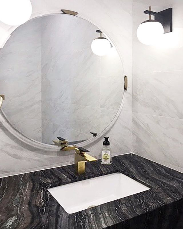 A classic bathroom tiled with marble looking porcelain for a timeless look. Installation by @nf.construction | #interiordesign #bathroomdesign #marblelook #monseyny #ceramiccreations