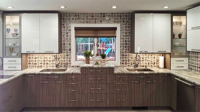 Our in-house design team helped this family find a backsplash to truly express themselves and finish off their new kitchen by @thekitchenpro 🍽🍾 | #kitchendesign #backsplash #mosaictile #ceramiccreations
